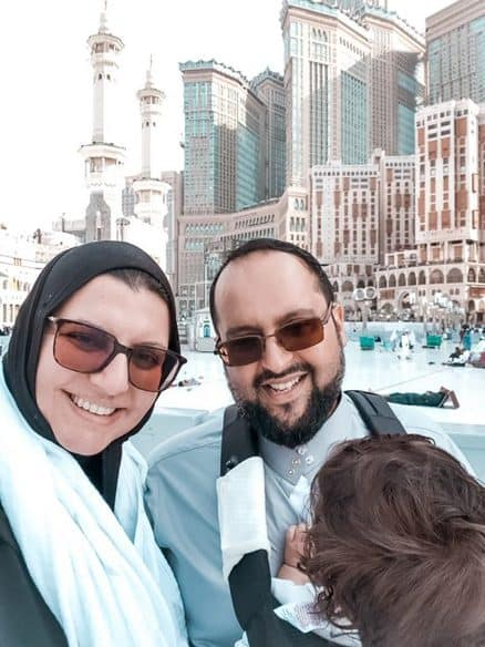 Holding our daughter while on Umrah in the carrier